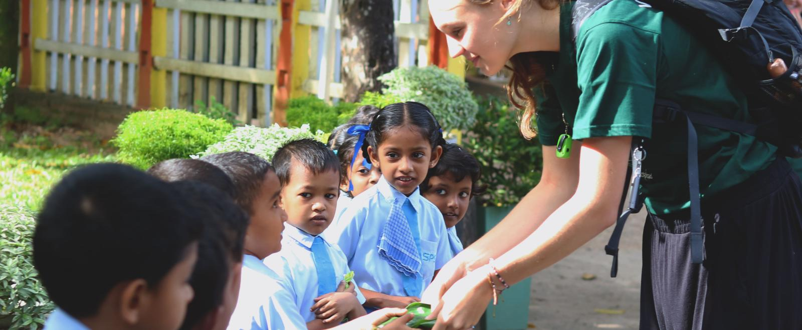ASDAN volunteer recieves a gift from the schoolchildren at her placement in Sri Lanka.